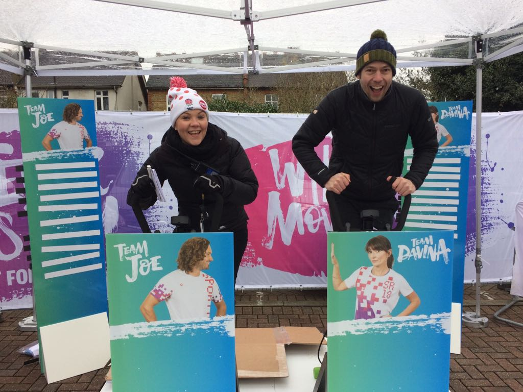 Leaderboard outside on a trade stand with exercise bikes