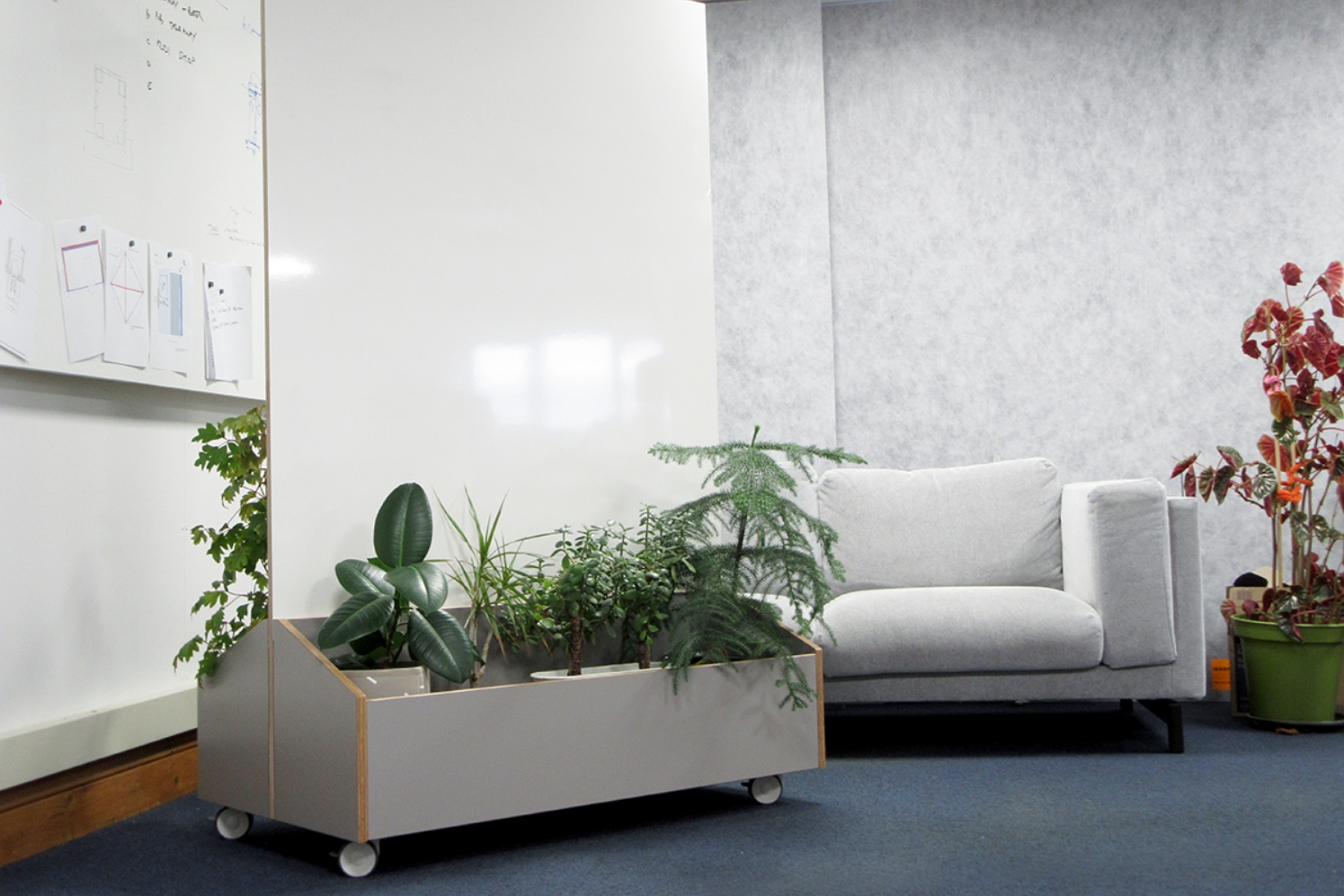 Freestanding whiteboard with built in planter